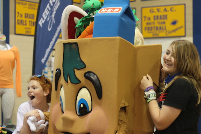 """Two students pose with """"H-E-B Buddy"""" during the Heights Health Expo. Photo by Joan Vinson."""