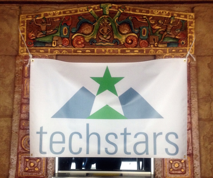 A Techstar banner hangs beneath a decorated arch. Photo by Lily Casura.