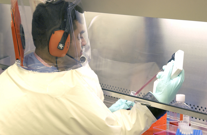 "Scientists at Texas Biomedical Research Institute work in the ""hot zone"" lab with highly lethal agents for which there are no vaccines or cures. Photo by Clem Spalding , courtesy of TBRI."