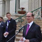 Bexar County Judge Nelson Wolff speaks during the Voting App Launch at City Hall. Photo by Iris Dimmick.