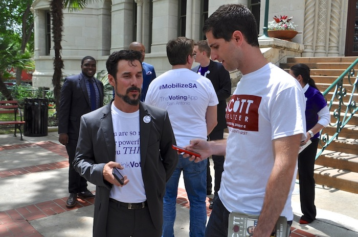 ThinkVoting co-founder F. Joseph Santori speaks with SAISD District 6 candidate Scott Meltzer during the Voting App Launch at City Hall. Photo by Iris Dimmick.