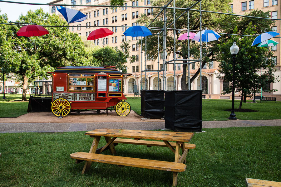 The popcorn cart sits under The Art of Umbrellas at Travis Park. Photo by Jacqueline Fierro.