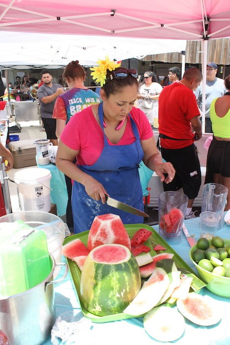 Lupita's Aqua Frescas staff member works during the 2015 Barbacoa & Big Red Festival. Photo by Kay Richter.