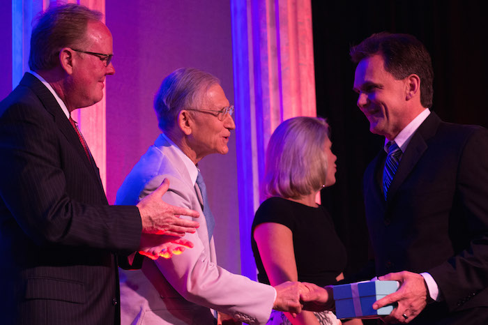 Michael Clark, right, shakes hands with H-E-B chairman and CEO Charles Butt during the 2015 H-E-B Excellence in Education Awards on Sunday. Courtesy photo.