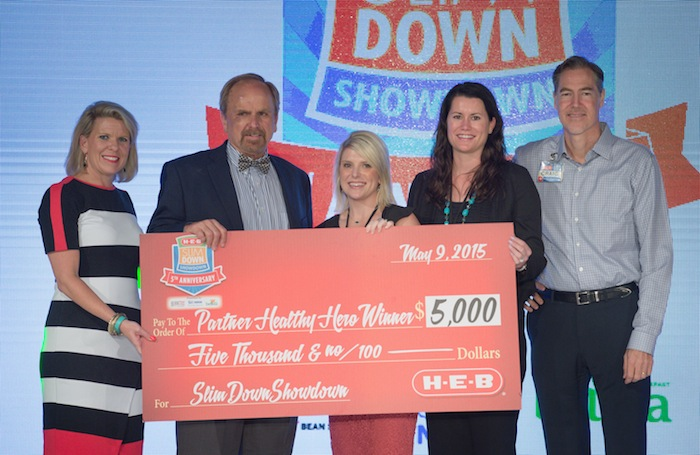 Kate Rogers (L-R), H-E-B VP of communications and engagement, partner Healty Hero winner James Griffith, H-E-B business development manager Heidi Deen, belVita representative Darah Detoro, and Craig Boyan, H-E-B President and COO, post for a photograph during the H-E-B Slim Down Showdown, Saturday, May 9, 2015, in San Antonio, Texas. Courtesy photo.