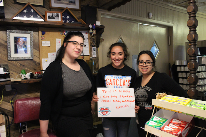 Three young women participate in the #ConSafoSanAntonio challenge, standing inside of Garcia's Original Mexican Food. Courtesy Photo.
