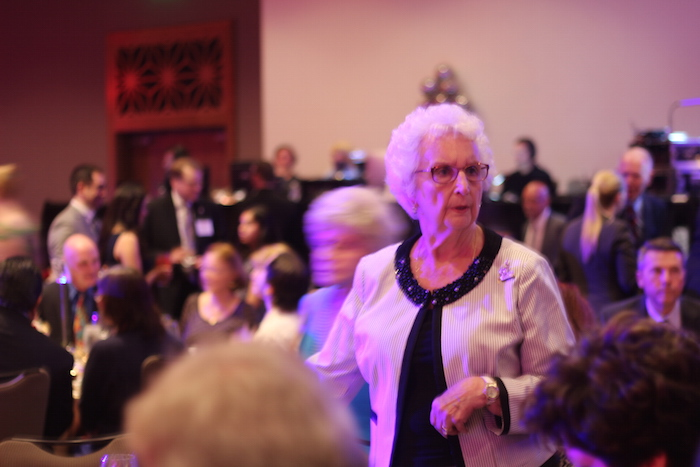 An attendee looks for her seat before the start of the H-E-B Excellence in Education Awards banquet. Photo by Joan Vinson.