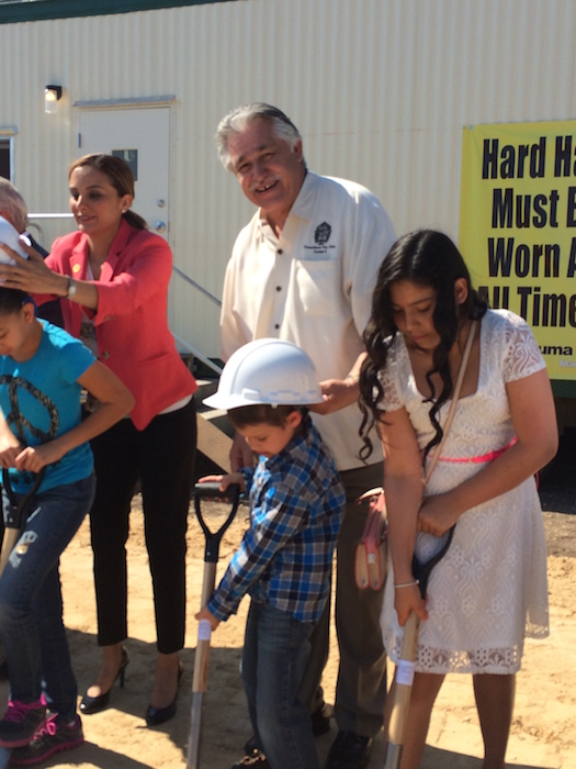 State Representative Ina Minjarez and District 6 City Council Representative Ray Lopez join Lucas Rico (in the hard hat) and future students for the groundbreaking ceremony of Carpe Diem Innovative School - Westwood. Photo by Bekah McNeel