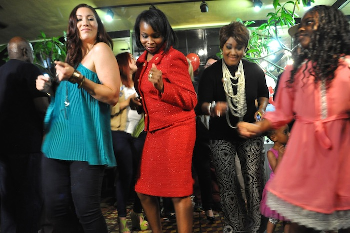 Mayor Ivy Taylor dances with friends and family during her election watch party. Photo by Iris Dimmick.