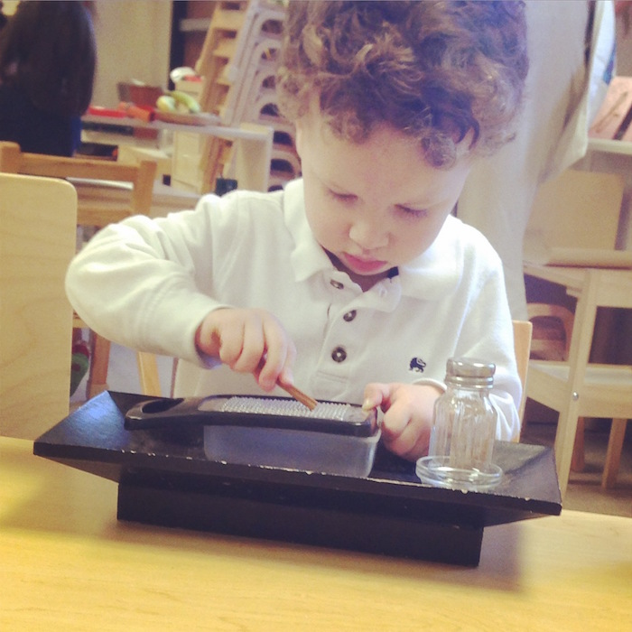 A student enjoys hands-on learning at Magnolia Montessori for All. Courtesy photo.