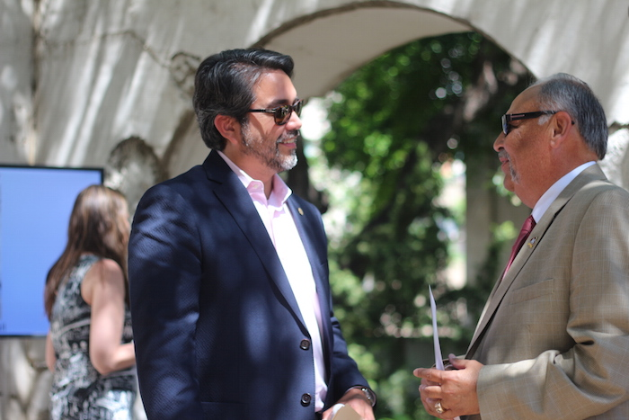 Councilmember Roberto Treviño (D2) speaks with an attendee after the State of Preservation Address at the Spanish Governor's Palace. Photo by Joan Vinson.