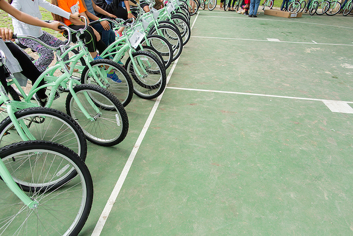 Girls line up their new bikes during the Chiquitas Ciclistas event in the Eastside. Photo by Rachel Chaney