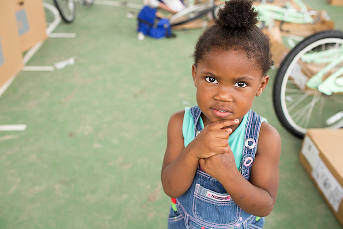 A young girl ponders a photographer during the Chiquitas Ciclistas event in the Eastside. Photo by Rachel Chaney