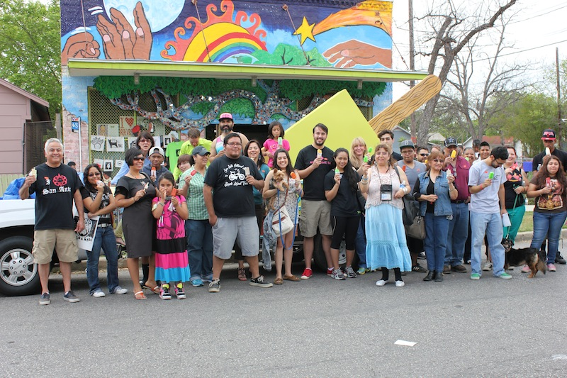 San Anto Cultural Arts organizers and community members gather for a group photo in front of their new paleta bike rack in March 2013. Photo by Melanie Robinson.