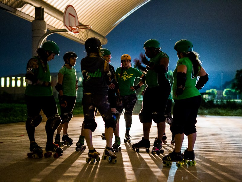 Alamo City Roller Girls group together during a practice. Photo by Scott Ball.