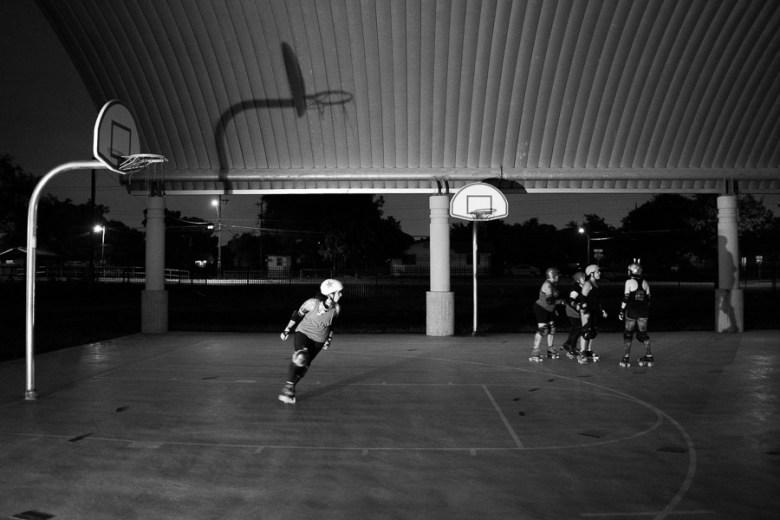 A jammer skates around during practice. Photo by Scott Ball.