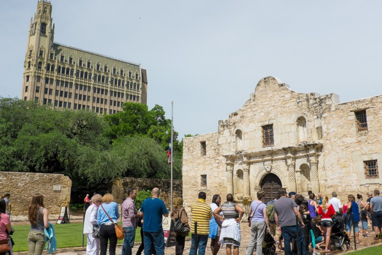 Visitors line up in front of The Alamo.  Photo by Scott Ball.