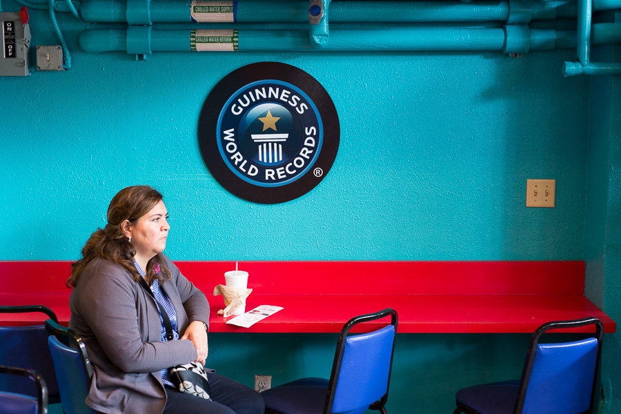 A woman sits at a snack bar at the Guiness World Records gift shop. Photo by Scott Ball.