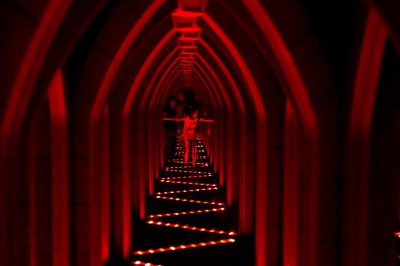 A girl walks through a mirror maze. Photo by Scott Ball.