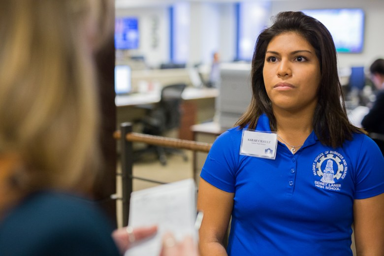 Lanier High School International Banking & Business Magnet  student Sarah Chavez speaks with reporters while touring the Frost Bank bond trading floor. Photo by Scott Ball.
