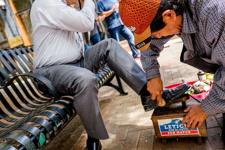 Jesús Mendez shines a black leather shoe in downtown San Antonio. Photo by Scott Ball.