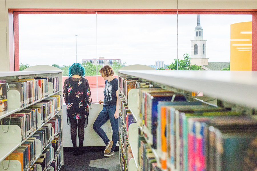 Two teenagers read a book at the newly opened Teen Library in the Central Library. Photo by Scott Ball.