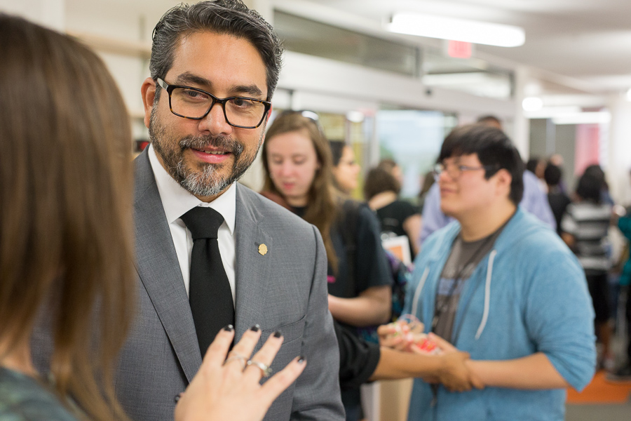 Councilman Roberto Trevino speaks with Jennier Velasquez at the newly opened Teen Library in the Central Library. Photo by Scott Ball.