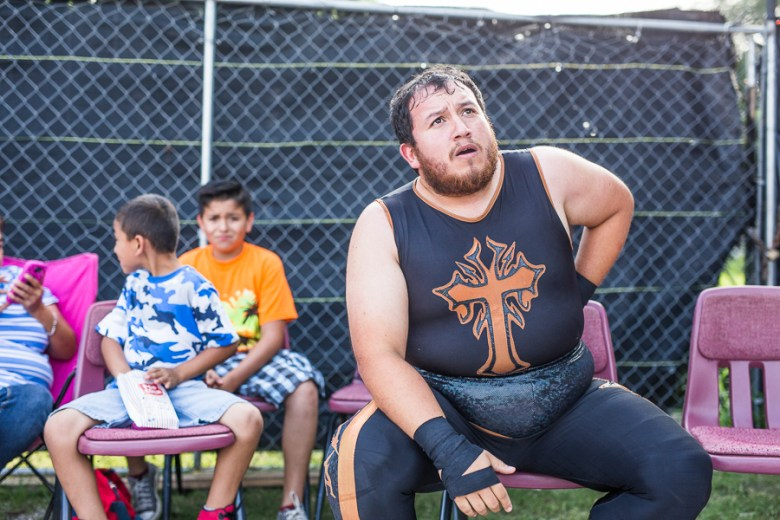 A luchador takes a break after being thrown out of the ring. Photo by Scott Ball.