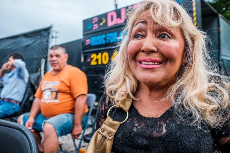 Spectator Lisa Saenz smies as she watches a match. Photo by Scott Ball.