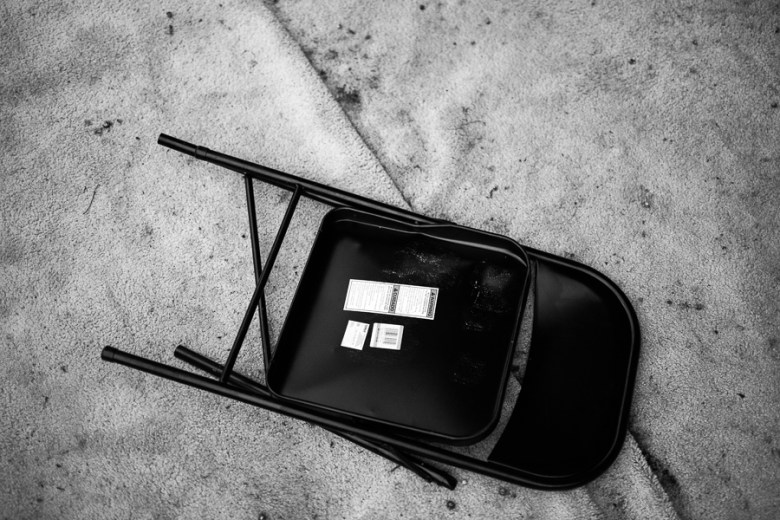 A broken chair lays on the ground after the event. Photo by Scott Ball.