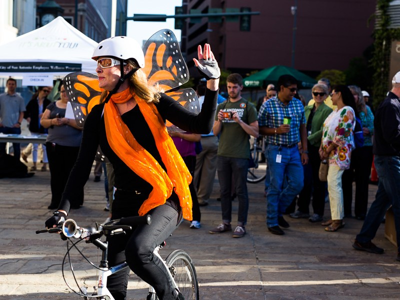 Julia Murphy waves to the crowd during the 19th annual Walk & Roll Rally. Photo by Scott Ball.
