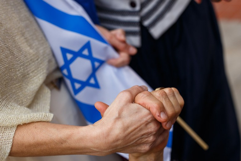 A group holds hands during National Day of Prayer at City Hall on Thursday. Photo by Scott Ball.