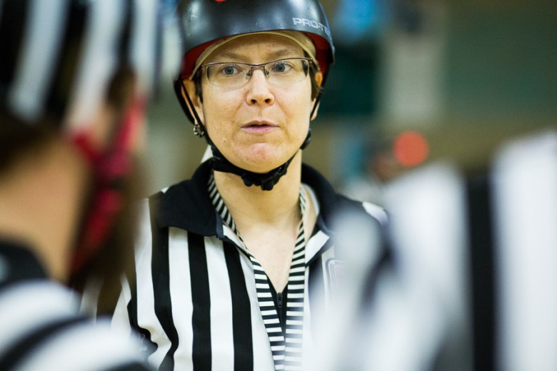 Referee Chop Stewie deliberates with other referees. Photo by Scott Ball