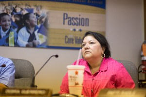 Debra Guerrero listens during a special board meeting. Photo by Scott Ball.