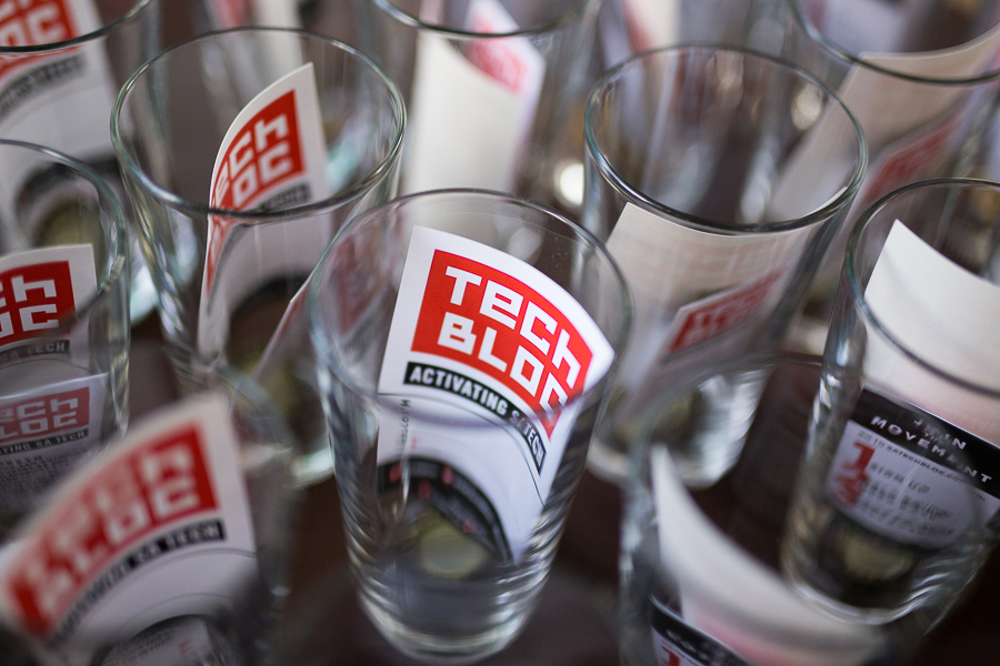 Tech Bloc cards are stuffed into pint glasses in which all attendees receive. Photo by Scott Ball.