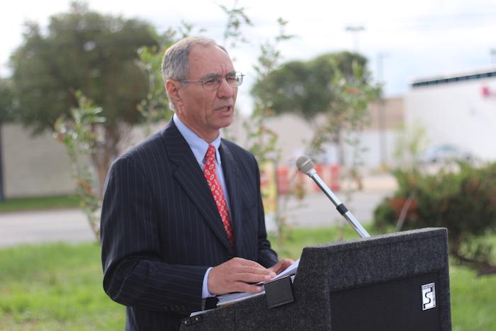 Razi Hosseini, assistant director for Transportation & Capital Improvements spoke during the Tezel Road ceremony. Photo by Joan Vinson.