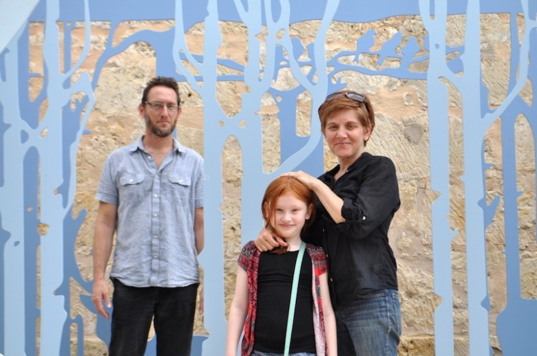 "From left: Paul Lewis, daughter Ruby, and artist Jennifer Khoshbin pose for a family photo in ""PLAY Theater."" Photo by Iris Dimmick."