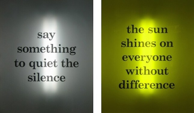 """Works by Benjamin McVey: (left) """"say something to quiet the silence,"""" 2013, acrylic glass, printed type on vellum, fluorescent lights, 36 x 30 in. and (right)  """"the sun shines on everyone without difference,"""" 2013, acrylic glass, printed type on vellum, fluorescent lights, 36 x 30 in."""