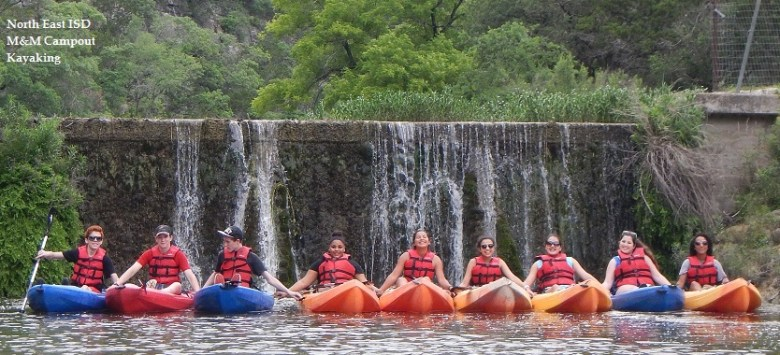 Students pose for a photo in kayaks. Photo courtesy of NEISD.