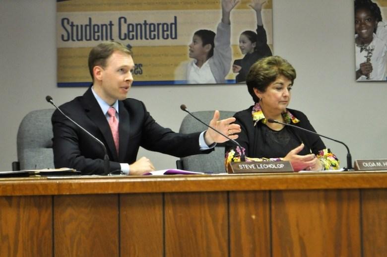 Trustee Steve Lecholop (D1) speaks to the board while Trustee Olga Hernandez (D6) looks on. Photo by Iris Dimmick.