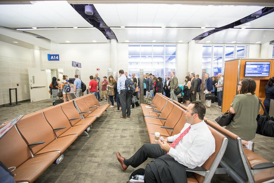 Passengers wait to board an aircraft. Photo by Scott Ball.