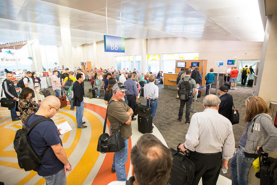 Passengers await a flight. Photo by Scott Ball.