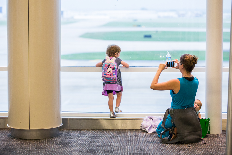 A mother takes a photo of her child before their flight at San Antonio International Airport.