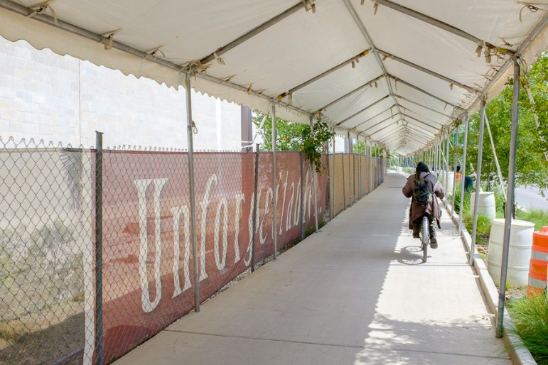 A cyclist rides down the path along Tower of Americas Way. Photo by Scott Ball.