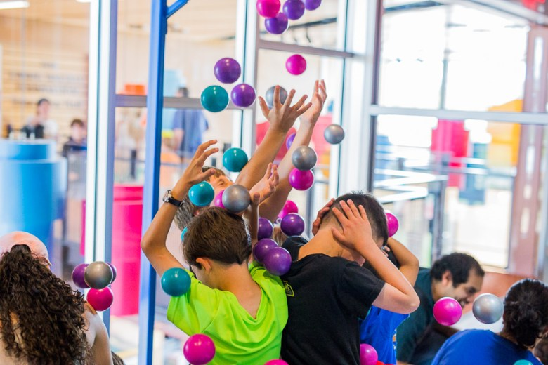 Plastic balls fall over children. Photo by Scott Ball.