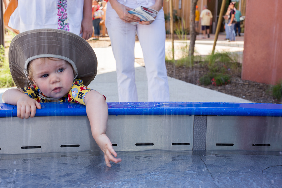 Moira tests the water at an outdoor exhibit. Photo by Scott Ball.