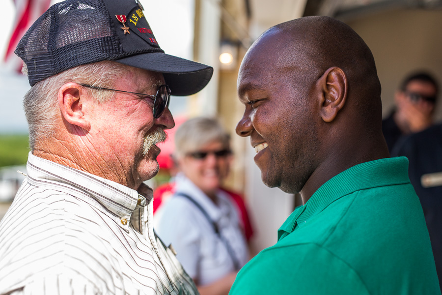 Haywood Grange has a personal conversation with a Vietnam Veteran. Photo by Scott Ball.