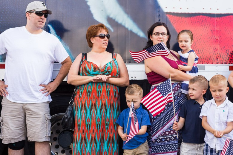 The Robinson family waits behind an H-E-B truck before the unveiling of their new home. Photo by Scott Ball.