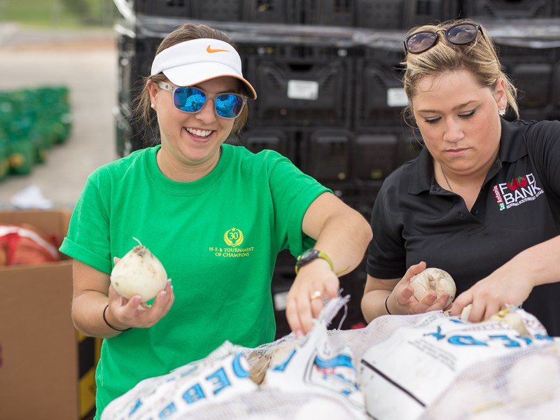 Volunteers pull onions for donation. Photo by Scott Ball.