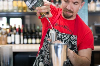 Jesse Torres of Mixtli pours mezcal. Photo by Scott Ball.